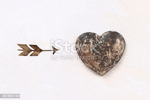 970844120 istock photo arrow and heart on textured background - love symbol 507800140