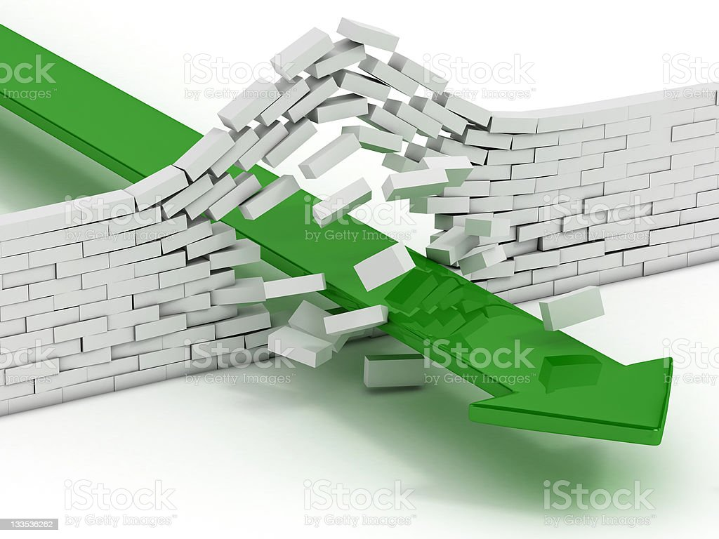 arrow breaking brick wall stock photo