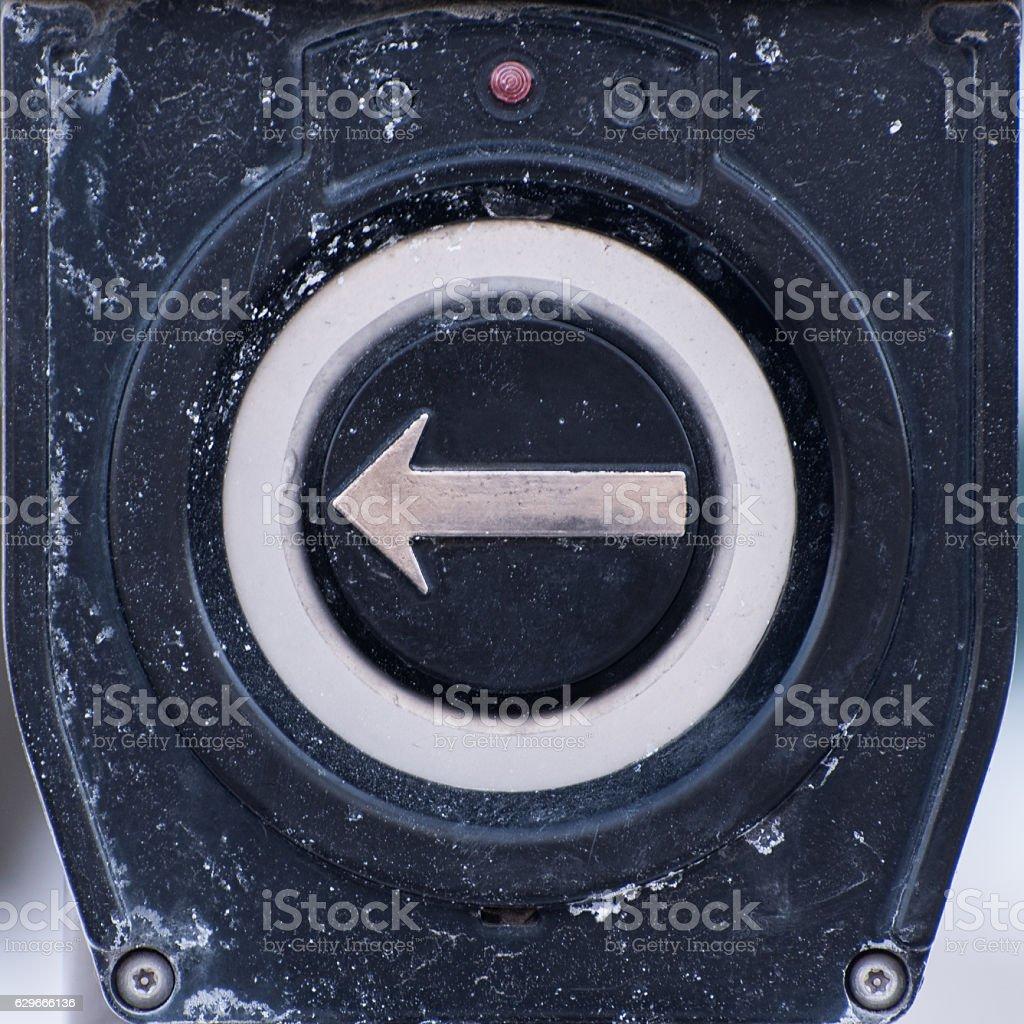 Arrow button on a pole stock photo