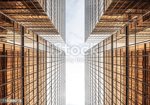 istock Arrow down. Finance buildings reflecting in each other, seen from below. 1150896779