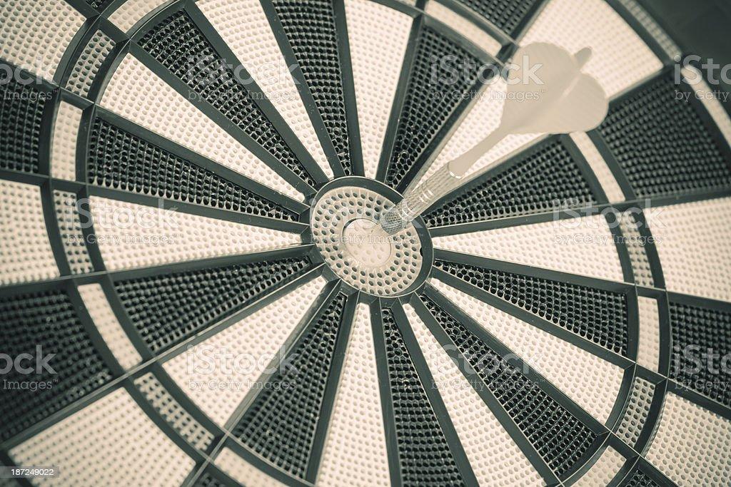 Arrow hits center of dart board royalty-free stock photo