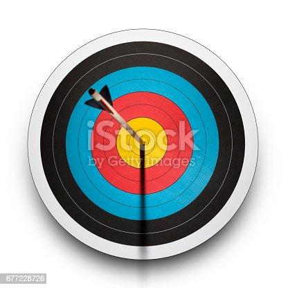 istock Arrow in the bullseye of an archery target 677228726