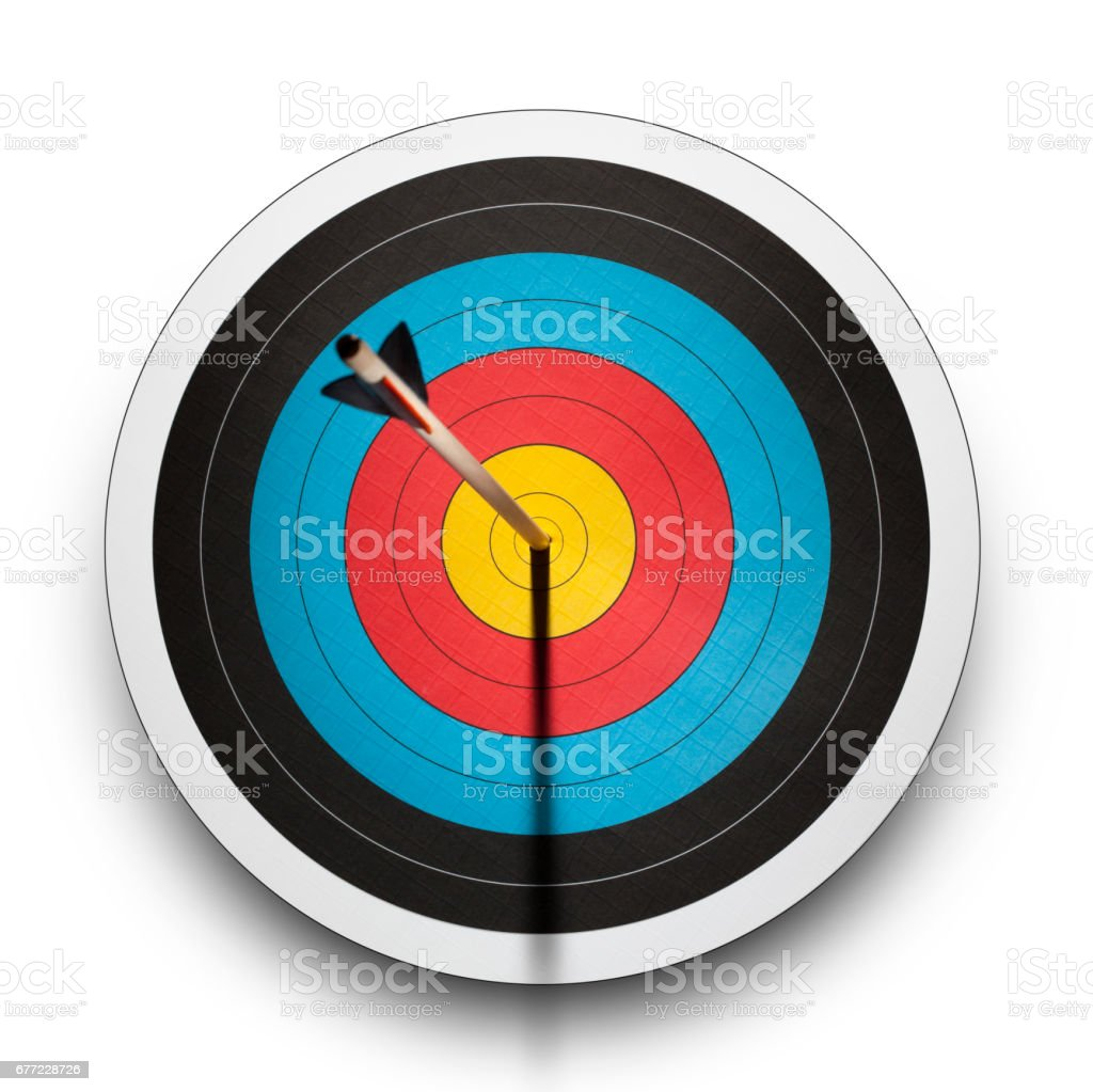 Arrow in the bullseye of an archery target stock photo