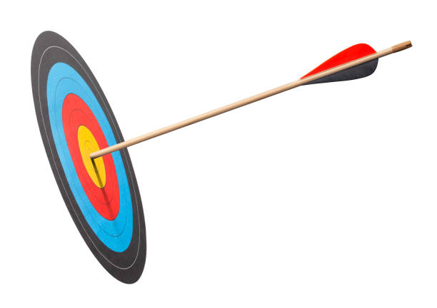 arrow in the bullseye of an archery target - arrow bow and arrow stock pictures, royalty-free photos & images