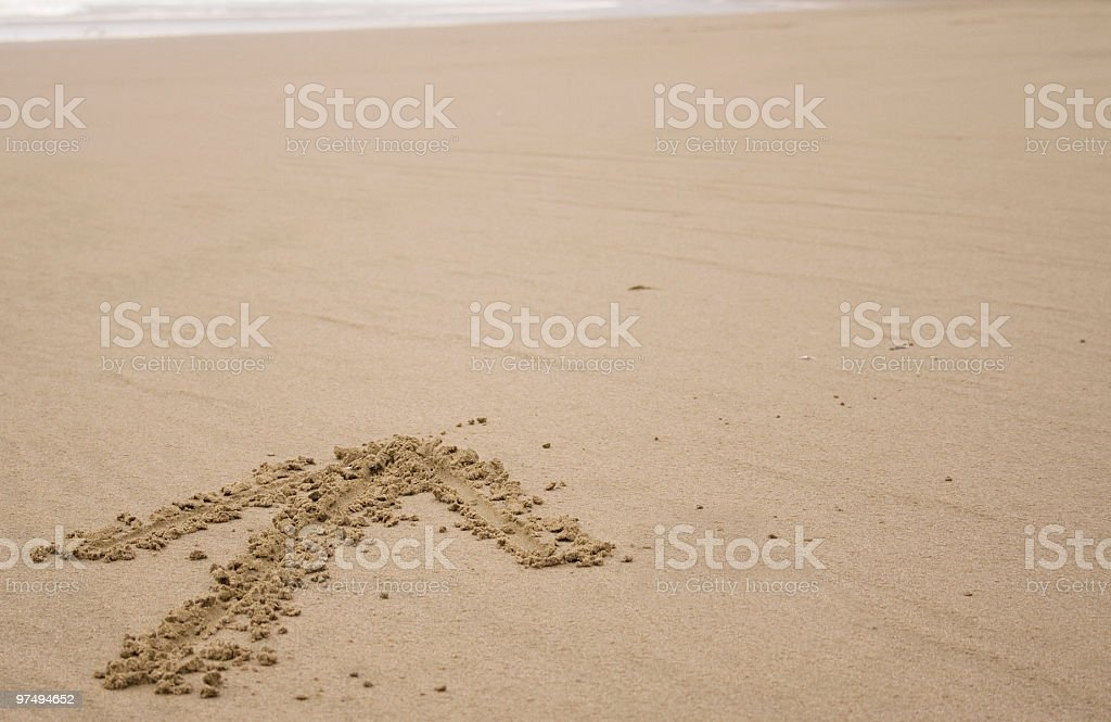 Arrow in the sand royalty-free stock photo