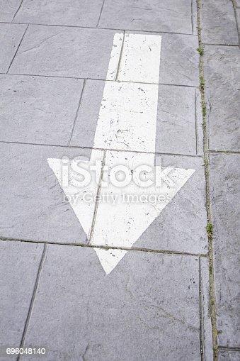 istock Arrow in tile 696048140