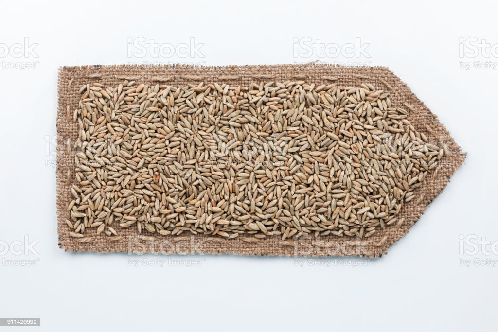 Arrow made of burlap with rye grains. stock photo