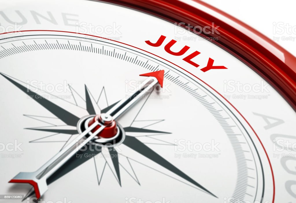 Arrow of A Compass Pointing July Month stock photo
