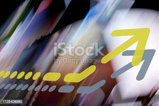 istock Arrow on abstract graphic background 1125408580