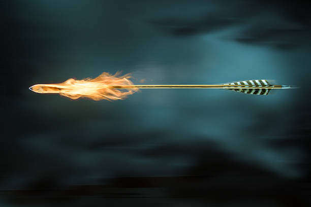 arrow on fire - arrow bow and arrow stock pictures, royalty-free photos & images