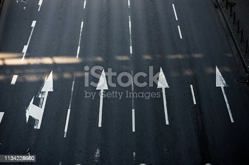 istock Arrow on road 1134228660