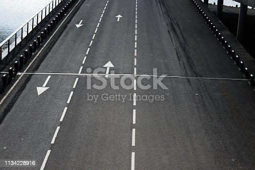 istock Arrow on road 1134228916