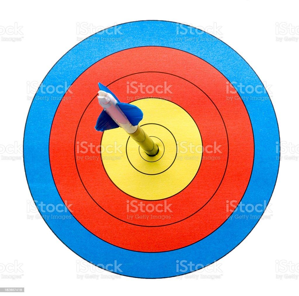 Arrow on target hitting bull's-eye. royalty-free stock photo