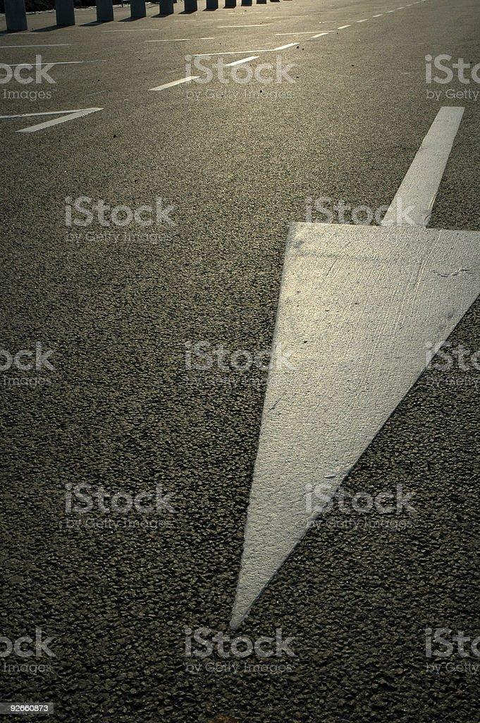 Arrow on the road 2 royalty-free stock photo