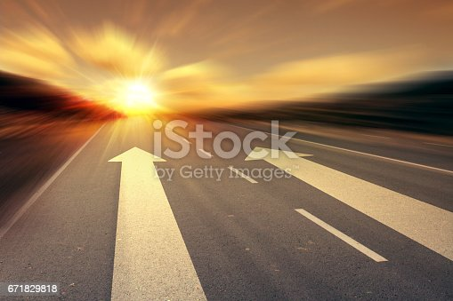 istock arrow on the road 671829818