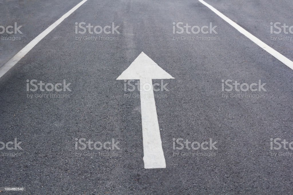 Arrow Painted On Street With White Paint Asphalt Stock Photo