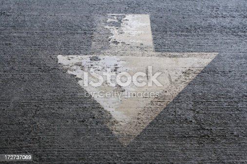 istock Arrow pointing down on asphalt 172737069