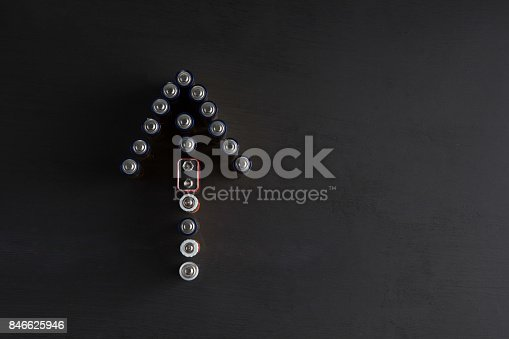 istock Arrow pointing up made of used batteries on black background with copy space 846625946
