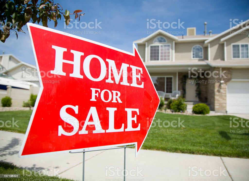 Arrow Shaped Home For Sale Sign royalty-free stock photo