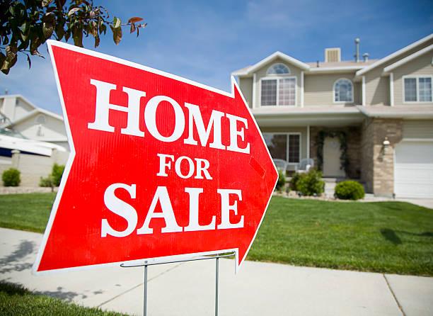 Arrow Shaped Home For Sale Sign An arrow shaped red