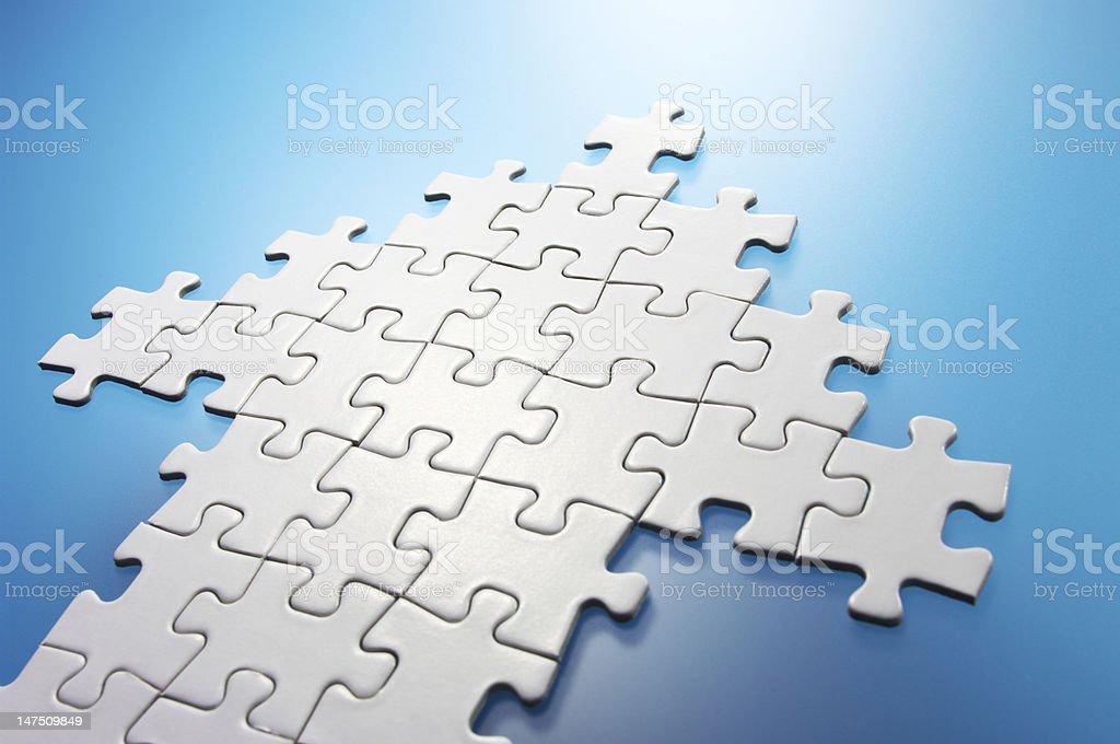 Arrow shaped jigsaw puzzle. stock photo
