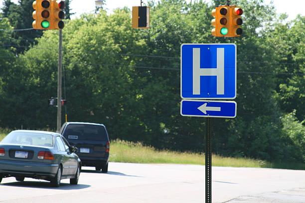 Arrow Shows the Way: Hospital on Left stock photo