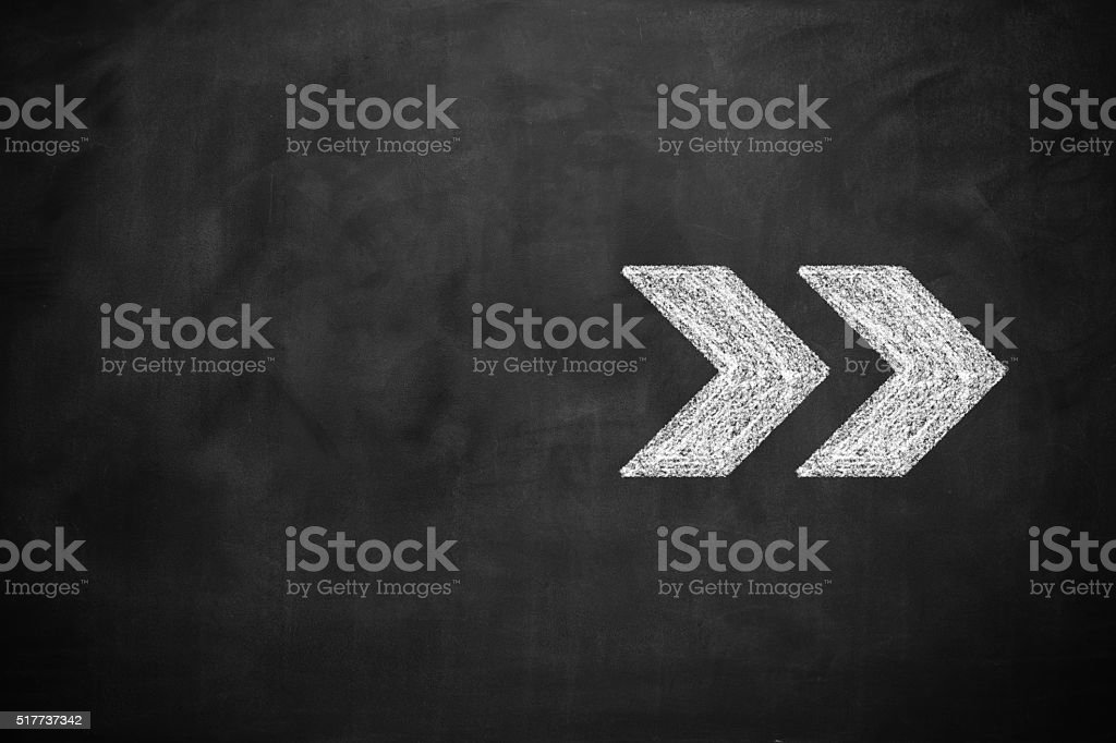 Arrow sign draw on blackboard stock photo