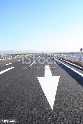 677206912 istock photo arrow sign painted on the road 485542257