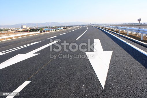 677206912 istock photo arrow sign painted on the road 485585719