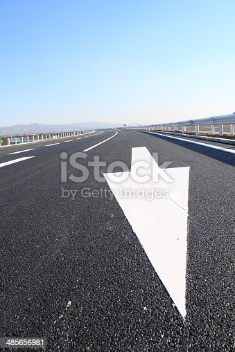 677206912 istock photo arrow sign painted on the road 485656981