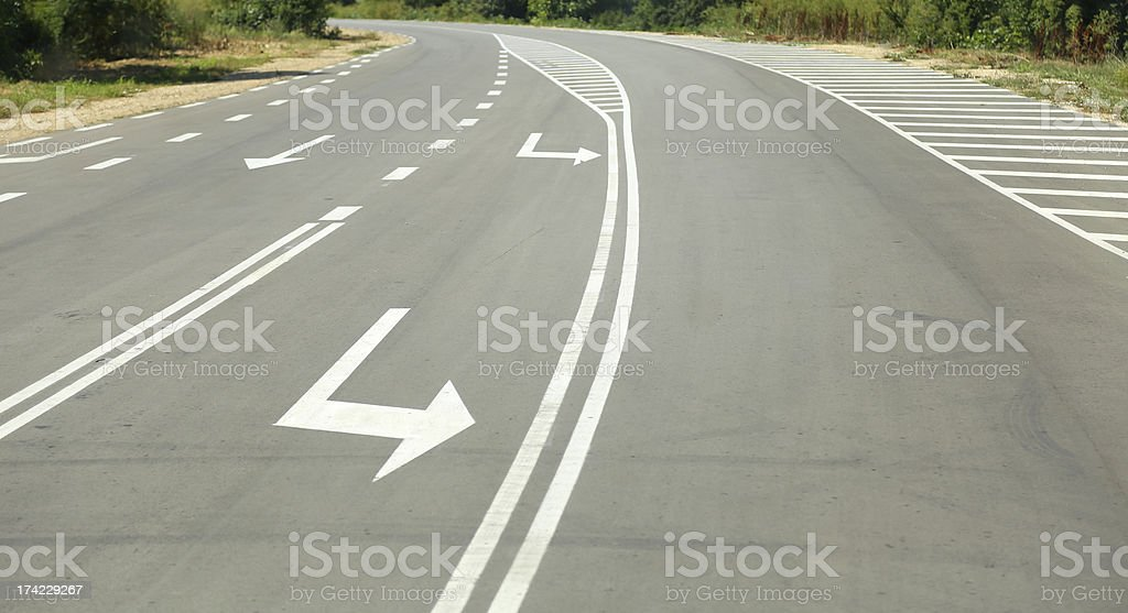 Arrow signs as road markings on suburban driveway royalty-free stock photo
