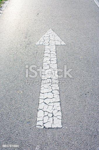 954712506istockphoto Arrow straight on the road background 664761694