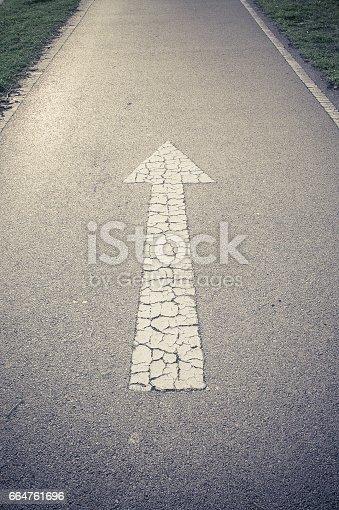 954712506istockphoto Arrow straight on the road background 664761696