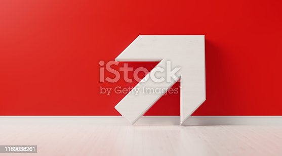 Arrow symbol is standing in front of red wall. Horizontal composition with copy space, Great use for growth concept.