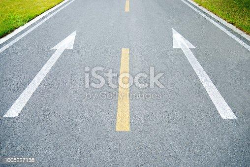 Arrow symbol on empty walkway