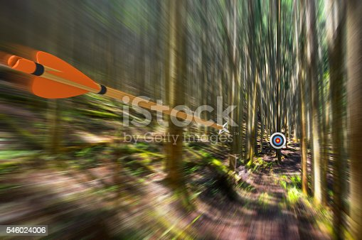 istock Arrow traveling through air at high speed to archery target 546024006