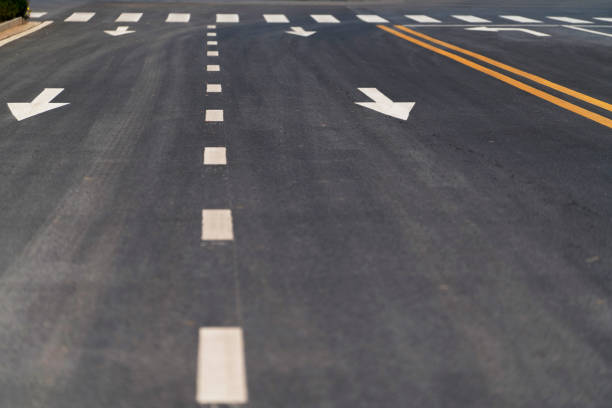 arrows and lines on driveway - dotted line stock photos and pictures
