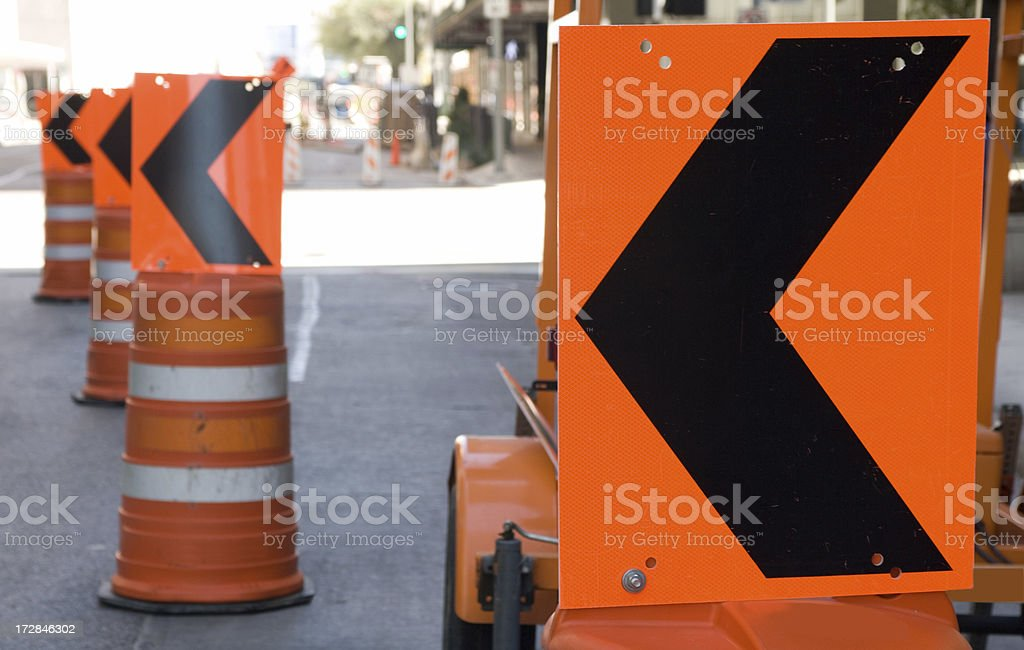Arrows around road construction Arrows mounted on top of barrels in downtown Houston, Texas. Arrow Symbol Stock Photo
