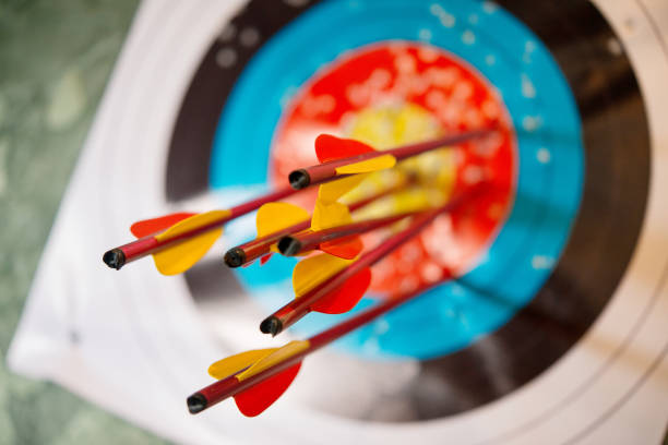 arrows from a bow accurately hit the target arrows from a bow accurately hit the target formic acid stock pictures, royalty-free photos & images