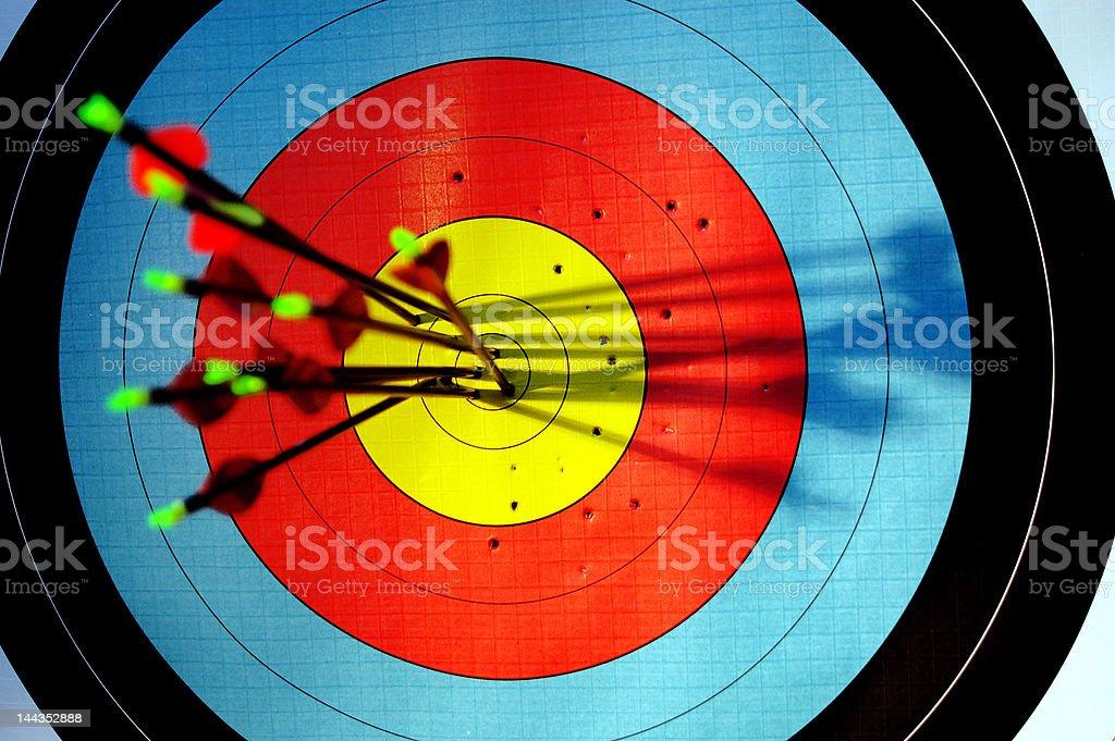 arrows hitting bullseye of archery target stock photo