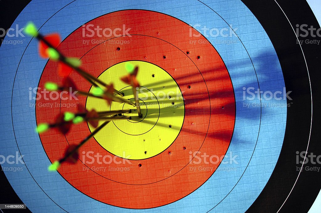 arrows hitting target stock photo