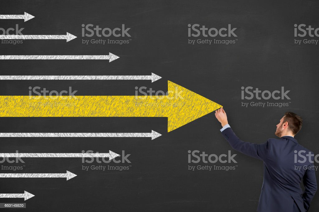 Arrows Leadership Concepts on Chalkboard Background stock photo