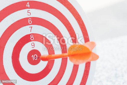 istock Arrows on archery target of dartboard Target business concept 946399432