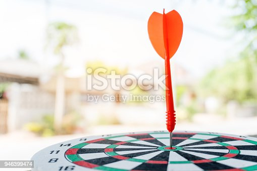 istock Arrows on archery target of dartboard Target business concept 946399474