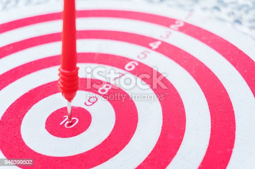 istock Arrows on archery target of dartboard Target business concept 946399502