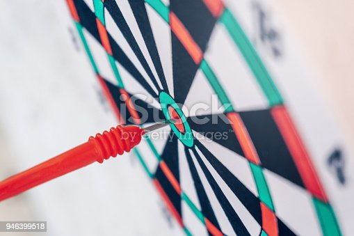 istock Arrows on archery target of dartboard Target business concept 946399518