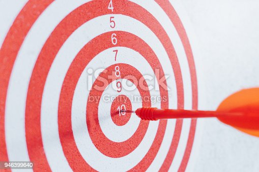 istock Arrows on archery target of dartboard Target business concept 946399640