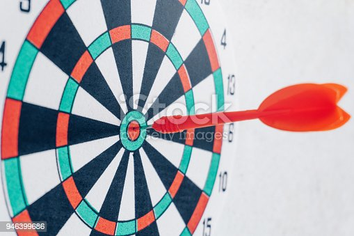 istock Arrows on archery target of dartboard Target business concept 946399686