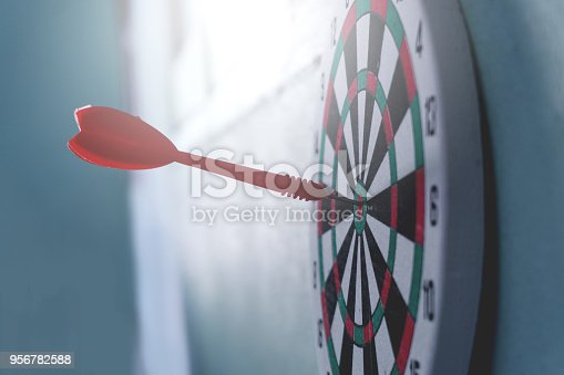 istock Arrows on archery target of dartboard Target business concept 956782588