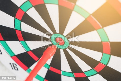 istock Arrows on archery target of dartboard Target business concept 956782740